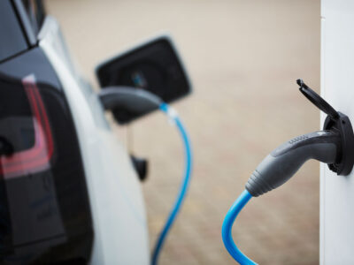 electric-car-being-charged-with-a-cable-connected--DGHRCKP